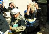 Iraqi Shiites Throw Dust on Their Heads in Grief