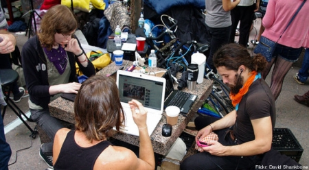 Occupiers with Computers and iPhones because of Capitalism