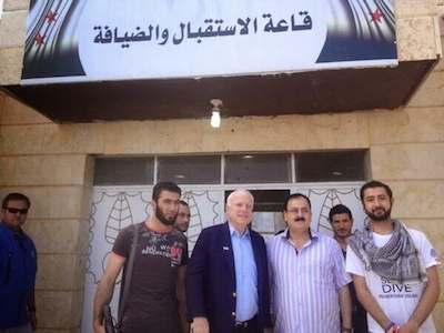 Senator John McCain cheeses it up with some terrorists